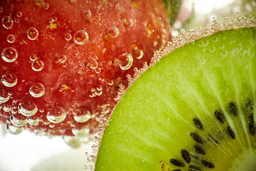 Fresh fruits in the water with drops of water