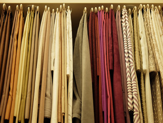 Rolls of fabric and textiles in store, close up
