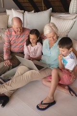 Multi-generation family using laptop