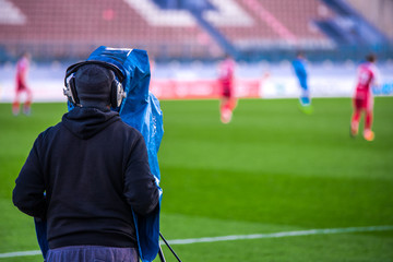 Cameraman on soccer, TV broadcast sport, media