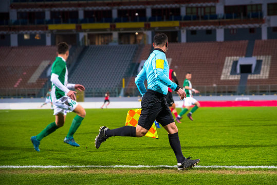 Football, soccer referee in game