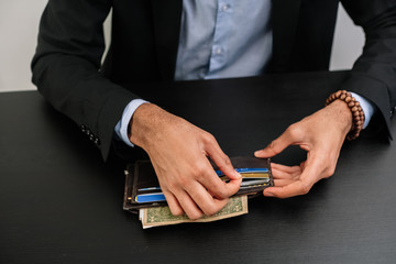 Man pulling money from wallet