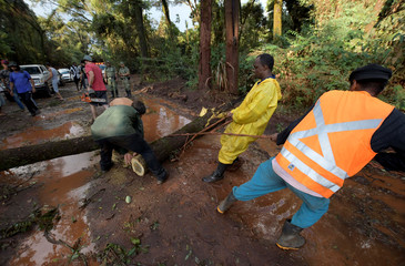 Residents and rescue workers try to unblock road following heavy rain after a tailings dam owned by Brazilian mining company Vale SA collapsed, in Brumadinho