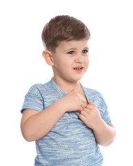 Little boy scratching chest on white background. Annoying itch