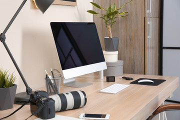Interior of comfortable work place with computer on table at home