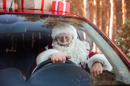 Authentic Santa Claus in car, view through windshield