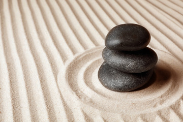 Photo sur Plexiglas Zen pierres a sable Stacked zen garden stones on sand with pattern, space for text. Meditation and harmony