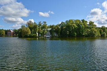 mansion on the island on the lake hidden among the trees