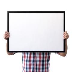 Holding frame mockup. Photo Mockup. The man hold frame. For frames and posters design. Frame size 28x20 (70x50cm).