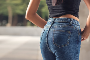 Asian female buttocks in jeans