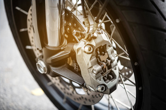 Motorcycle wheel with ABS brakes, selective focus.