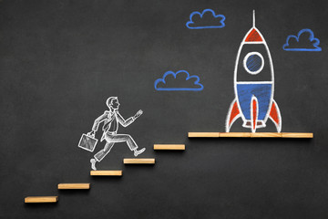 Career Planning and Business Challenge Concept with Hand Drawn Businessman and Rocket Chalk Illustrations on Blackboard