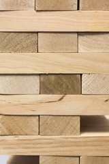 Board game jenga. Wooden blocks. A logic game for two and a company. Entertainment for adults and children. Useful leisure. Educational toys. Wooden bricks. Tower of cubes.