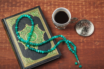 Fotobehang Schip Holy Quran with beads over wooden background close up
