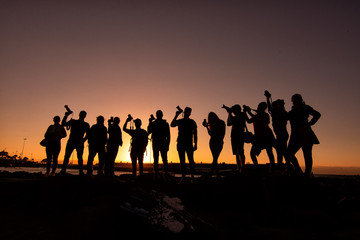 photographers at the sunset, backlighting