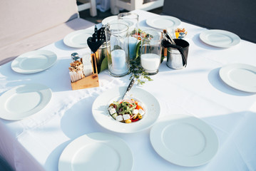 Served table for meeting guests in the open air in anticipation of the holidays