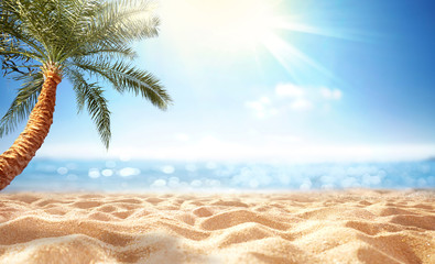 Summer background, nature of tropical beach with rays of sun light. Golden sand beach, palm tree, sea water against blue sky with white clouds. Copy space, summer vacation concept.