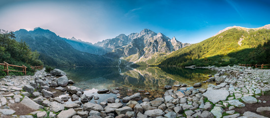 Tatra National Park, Poland. Panorama Famous Mountains Lake Morskie Oko Or Sea Eye Lake In Summer Morning. Five Lakes Valley. Beautiful Scenic Viev