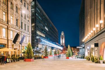 Foto auf Leinwand Skandinavien Helsinki, Finland. Night View Of Keskuskatu Street In Evening Christmas New Year Xmas Festive Illumination. Shopping Mall And Helsinki Central Railway Station