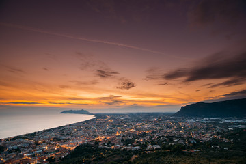 Terracina, Italy. Top View Skyline Cityscape City In Evening Sunset. City Illuminations