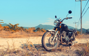 Motorbike under sky.Vintage color photo effect added