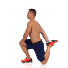 Man Stretches Leg Quadriceps.