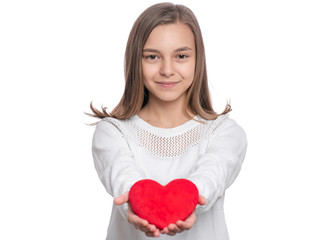 Happy Valentines Day. Cute young Teen Girl in Love with Red plush Heart in her hands. Smiling Child...