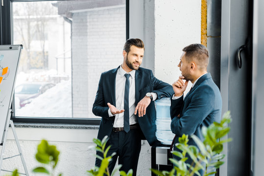 selective focus of businessman having discussion with coworker in modern office