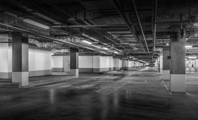 Empty car parking, new interiors spaces. Black and white photo