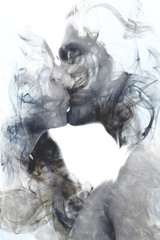 Double exposure of two blissful people close up embracing and becoming one with the smoky texture