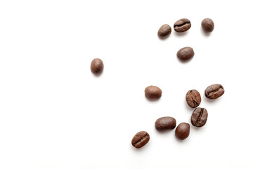 Coffee beans isolated on white background. Close-up. Wall mural