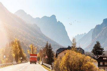 Road and car in Alpine mountains