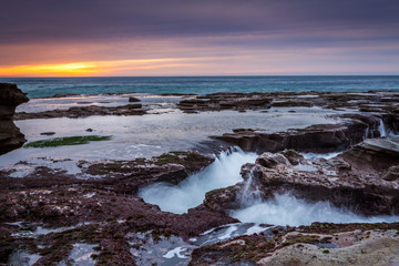 Ocean eroding out channels in the rocks