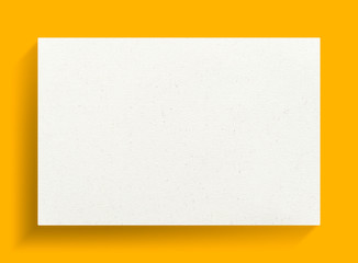 White canvas frame on yellow background.