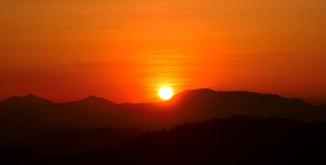 Canvas Prints Cuban Red Mountain view before sunset.Sunset in the mountains.Picture of a sun setting behind a dense forest area followed by mountains.