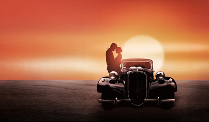 A young couple with a old retro car