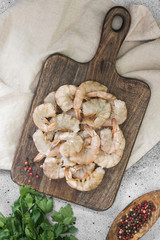 Fotorolgordijn Baobab Raw tiger prawns on wooden Board on grey background