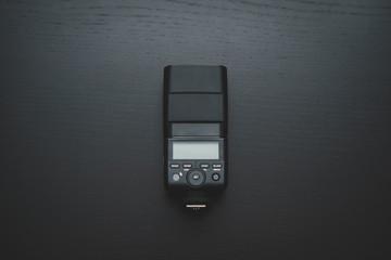 Camera flash on dark wooden desk