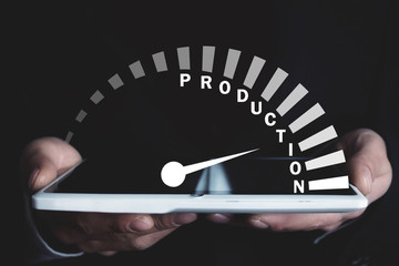 Man holding speedometer with Production word. Business concept