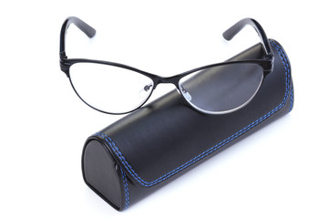 Optical glasses with leather case on white background