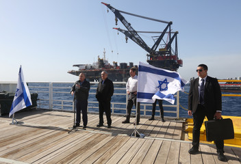 Israeli Prime Minister Benjamin Netanyahu and Energy Minister Yuval Steinitz speak during the inauguration event of the newly arrived foundation platform of Leviathan natural gas field, in the Mediterranean Sea, off the coast of Haifa