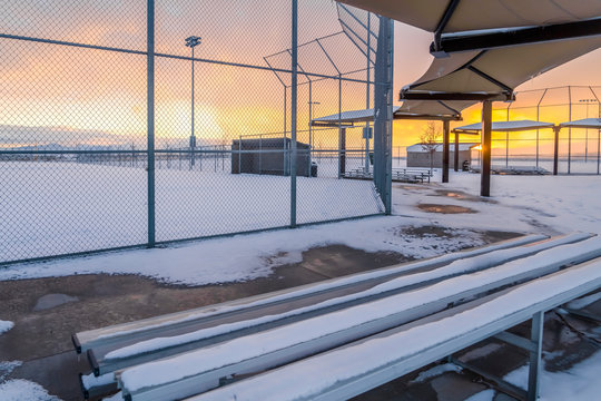 Snowy baseball field at sunset in Eagle Mountain