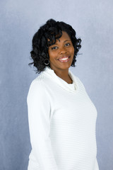 Beautiful African Amercian Woman in a white sweater with a grey background