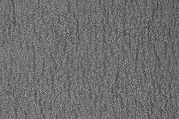 abstract rough gray surface background. Similar to asphalt, concrete, plastic. Gray matte texture of the cells.