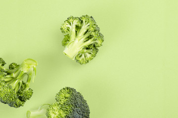 Minimalistic image of broccoli on bright background top view