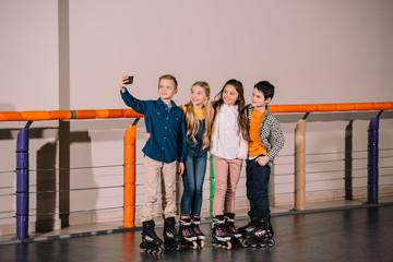 Roller skaters making selfie on skating rink