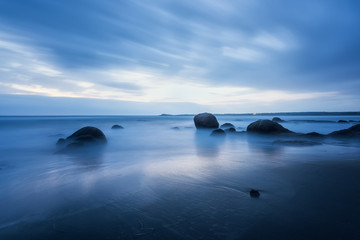 Magic blue morning at the beach / Amazing sea morning with slow shutter and waves flowing out