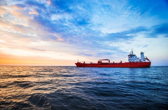 Colorful sunset over the North sea and tanker cargo ship on a background, Netherlands