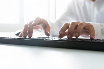 Typing on black keyboard