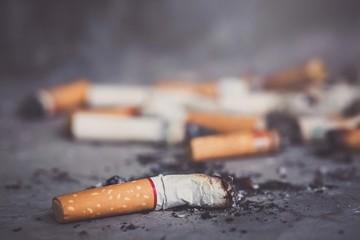 smoking a cigarette. pulverize the floor.